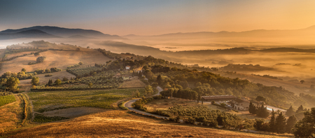 Tuscan Village Landscape scenery near Florence on a Foggy Morning in august, Italy Фото со стока