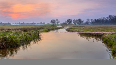 silt: Regge river, Twente Netherlands. A meander forms when moving water in a stream erodes the outer banks and widens its valley, and the inner part of the river has less energy and deposits silt.