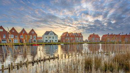 Street with New Modern Houses on the waterfront in a newly built ecological Urban Area in the Netherlands Banco de Imagens