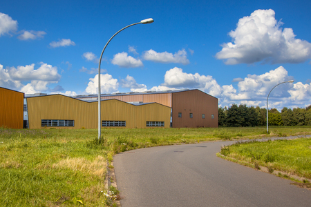 zoning: Contemporary industrial building in a commercial area under development Stock Photo