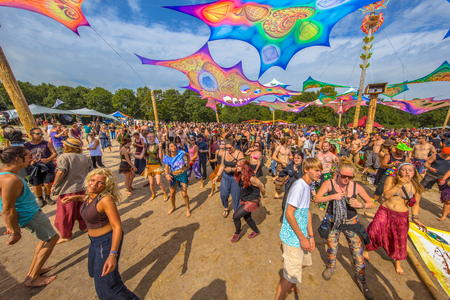 psy: LEEUWARDEN, NETHERLANDS-AUGUST 30, 2015: Colorful party people on the dance floor at Psy-Fi open air psychedelic trance music Festival Editorial