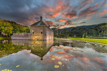 14th century: Sunset over Verhildersum castle or borg, which was built in the 14th century to defend the area against intruders around Leens, Netherlands