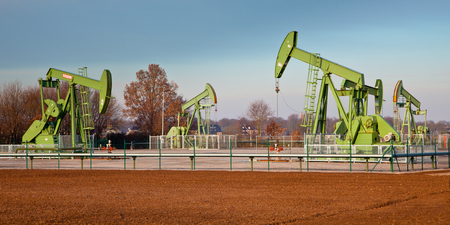 recursos naturales: Group of European Oil Pump Jacks in Germany in a station on a Sunny Day Foto de archivo
