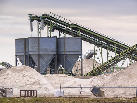 gravel: Mining belts are sorting sand on a construction site