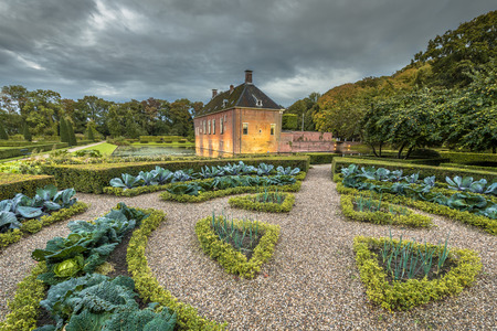14th century: Creative Garden with vegetables at Verhildersum castle. This borg was built in the 14th century to defend the area against intruders around Leens, Netherlands