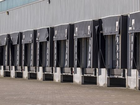 loading dock: Long row of Empty Loading Dock Cargo Doors as a concept for Economic Growth