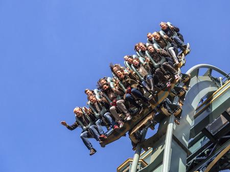 metres: KAATSHEUVELTHE NETHERLANDS - OCTOBER 31th, 2015: Efteling park ride new rollercoaster Baron 1898 just before a 40 metres vertical drop.