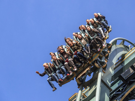KAATSHEUVEL/THE NETHERLANDS - OCTOBER 31th, 2015: Efteling park ride new rollercoaster Baron 1898 just before a 40 metres vertical drop. Imagens - 61176818
