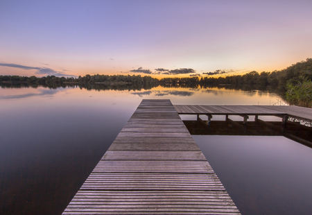 pier: Beautiful sunset seen from a pier in a quiet lake in the city of Groningen, Netherlands