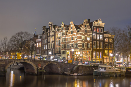 prinsengracht: Nightscape of Colorful traditional canal houses on the corner of brouwersgracht and Prinsengracht in the UNESCO World Heritage site of Amsterdam Editorial