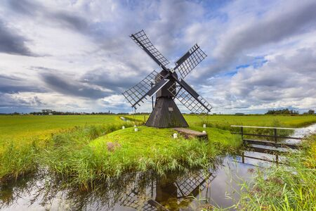 Traditional Wooden Windmill to Pump out Water from a Polder near Leeuwarden, Friesland, Netherlands Stock Photo