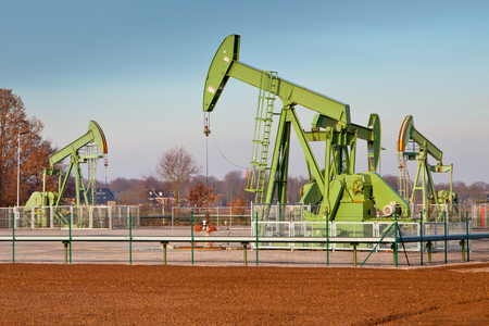 jacks: Group of European Oil Pump Jacks in Germany on a Sunny Day Stock Photo