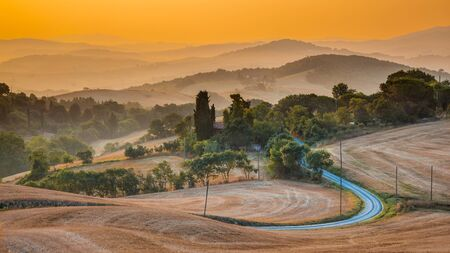 sienna: Tuscany hill Landscape near Florence on a Foggy Morning in august, Italy Stock Photo
