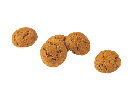 pepernoot: Pepernoten cookies in a row seen from above as Sinterklaas decoration on white background for dutch sinterklaasfeest holiday event on december 5th