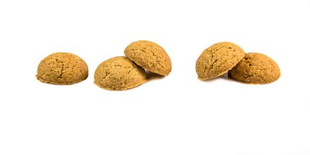 pepernoot: Five ginger nuts in a row as Sinterklaas decoration on white background for dutch sinterklaasfeest holiday event on december 5th Stock Photo