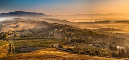 italy landscape: Scenic Landscape near Florence with farms and a village on a Foggy Morning in august, Italy