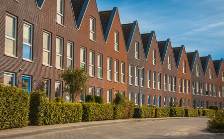 almere: Facade in row of Modern Real Estate Family houses in a suburban area in Europe
