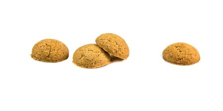 Four ginger nuts in a row as Sinterklaas decoration on white background for dutch sinterklaasfeest holiday event on december 5th