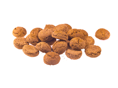 zwarte: Bunch of Pepernoten cookies seen from above as Sinterklaas decoration on white background for dutch sinterklaasfeest holiday event on december 5th