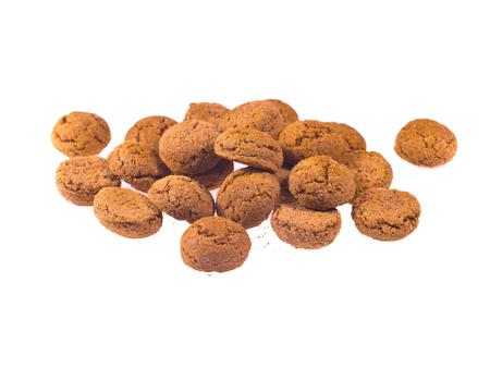 zwarte: Bunch of Pepernoten cookies seen from above as Sinterklaas decoration on white background for dutch sinterklaasfeest holiday event on december 5th