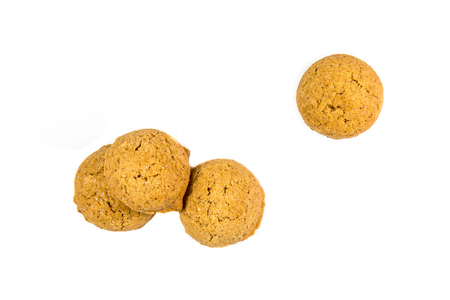 zwarte: Four scattered Pepernoten cookies or ginger nuts from above as Sinterklaas decoration on white background for dutch sinterklaasfeest holiday event on december 5th