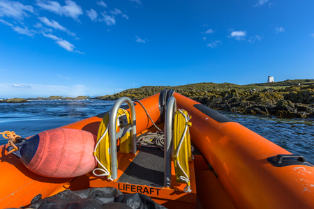 Bow of a Rigid inflatable boat out on sea on a sunny day Stock Photo