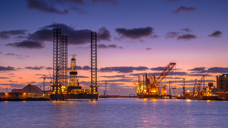 torres petroleras: Oil Platforms being built in a harbor under beautiful sunset