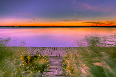ponton: Beautiful Sunset over Schildmeer near Appingedam in the Netherlands Stock Photo