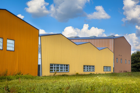 vacant land: Colorful new contemporary industrial building in a commercial area under development