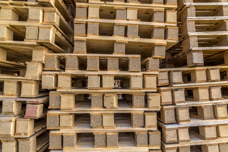 euro pallet: Background Close up of Piles of different types of pallet at a recycling business area