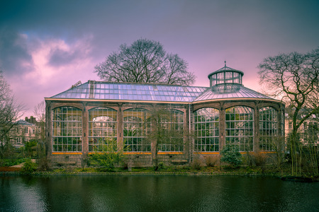 historic site: AMSTERDAM, NETHERLANDS - DECEMBER 29, 2016: Historic traditional greenhouse of the Hortus botanicus in the UNESCO World Heritage site of Amsterdam in retro look