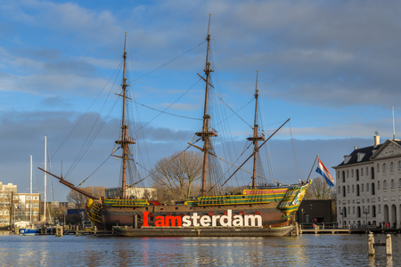 AMSTERDAM, NETHERLANDS - DECEMBER 29, 2016: The Amsterdam was an 18th-century cargo ship of the Dutch East India Company anchored in front of the Scheepvaartmuseum in the UNESCO World Heritage site of Amsterdam