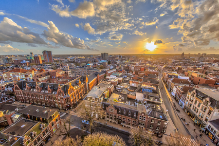 Helicopter View over historic part of Groningen city under setting sun
