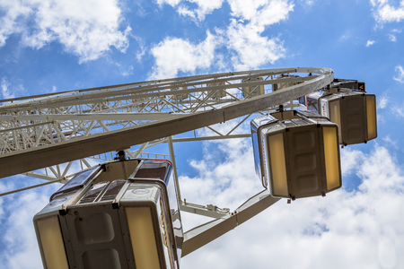 Big wheel seen from the ground on a funfair under summer sky Stock Photo
