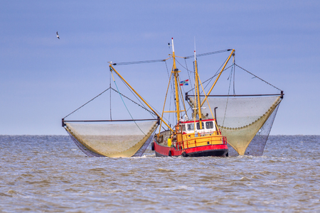 Shrimp fishing cutter vessel in the Dutch wadden sea Stock Photo