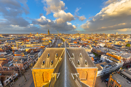 Groningen city aerial view seen from tower of the Aa church while last light of the day is falling over Vismarkt marketplace in city centre