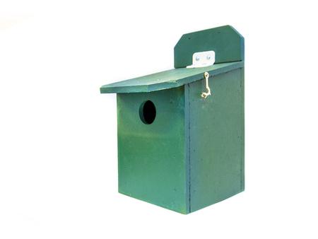 stimulate: Professional green birdhouse to stimulate urban garden wildlife Stock Photo