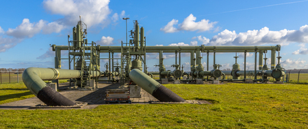 Old Natural gas field processing site in flat countryside