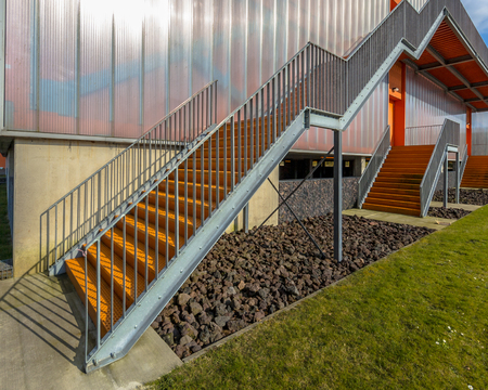building feature: Metal emergency exit escape ladder on the exterior of a building facade
