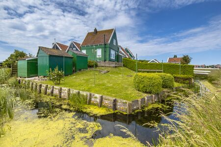 marken: Beautiful typical fisherman village houses in township Grotewerf on Marken island Waterland, the Netherlands Stock Photo
