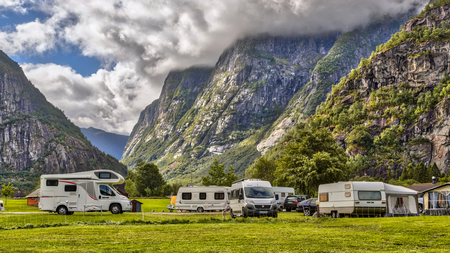 Caravans and campers on campsite between mountains near Hardangervidda National Park Norway Editorial