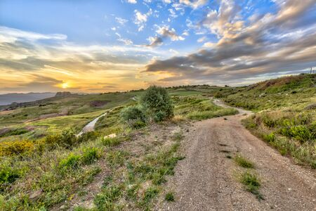 tera: Dirt Road through Mediterranean landscape on the island of Cyprus with hot semi-arid climate type BSh and corresponding vegetation
