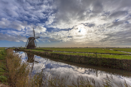 Traditional wooden windmill in Frisian countryside, Netherlands