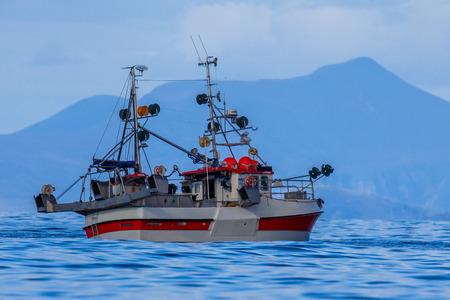Sustainable Commercial mackerel hook line fishing vessel in Norwegian fjord Stock Photo