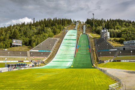 LILLEHAMMER, NORWAY - AUGUST 2, 2016: Ski jump slope near Oslo, known as Lysgardsbakken, opened in 1993, specifically to the XVII Olympic Winter Games in 1994. Now the centre of winter sports in Norway.