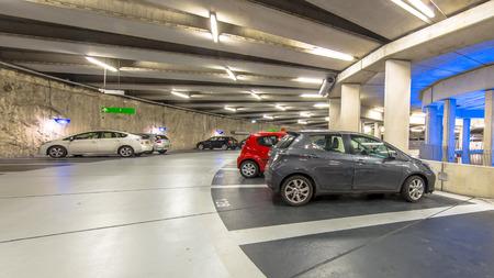 Underground circular parking garage with parked cars