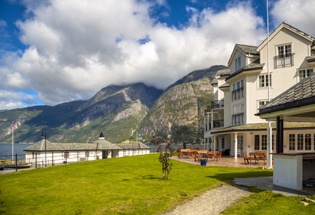 Touristic hotel in Eidfjord village Hordaland province Norway with mountain background