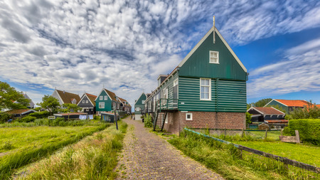 Beautiful typical fisherman village houses in township Wittewerf on Marken island in the Ijsselmeer or formerly Zuiderzee, the Netherlands Stock Photo