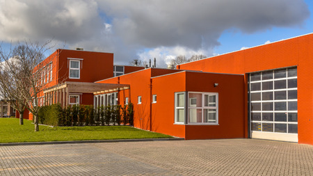 Modern commercial building with parking and warehouse