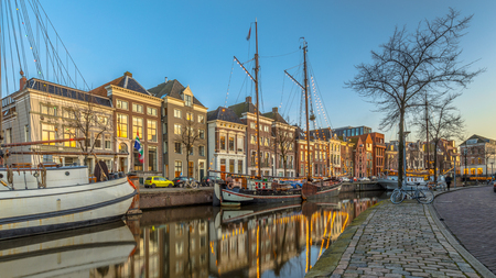 Historic buildings on Hoge der Aa Quay with ship in Groningen city centre at sunset, Netherlands Stock Photo